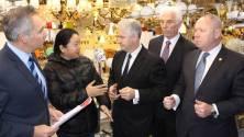 Price rise: Adam Searle with Fairfield MP Guy Zangari, Cabramatta MP Nick Lalich and Prospect MP Hugh McDermott talking to Lighting Town Cabramatta owner Ya Wang. Source: Fairfield City Champion
